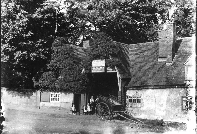 The smithy, wheelwright and coach-builder in Bridge Street, Kenilworth.  1912 |  IMAGE LOCATION: (Warwickshire County Record Office)