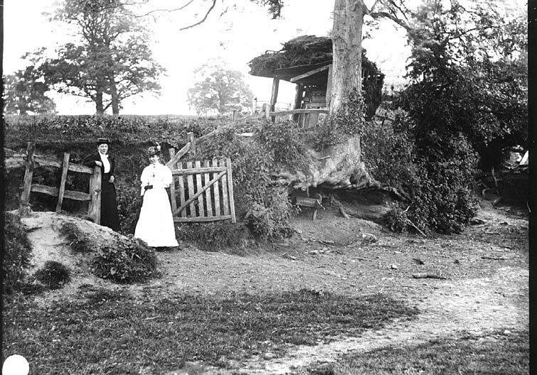 Two ladies standing by a gate in a hedge, Leek Wootton.  1910s |  IMAGE LOCATION: (Warwickshire County Record Office)