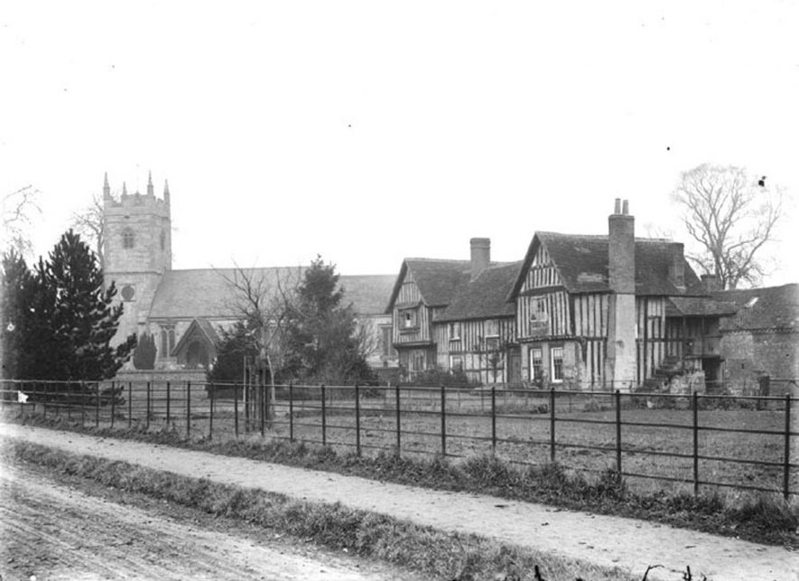 Clifford Chambers.  A large timber-framed house next to the church.  1900s |  IMAGE LOCATION: (Warwickshire County Record Office)