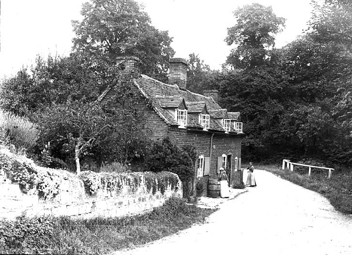 Cottages with two ladies standing in front. Temple Grafton.  1900s |  IMAGE LOCATION: (Warwickshire County Record Office)