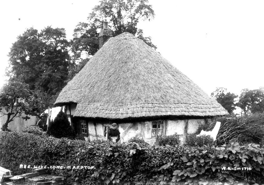 The Beehive, a small timber framed, thatched cottage. Long Marston.  1900s |  IMAGE LOCATION: (Warwickshire County Record Office)