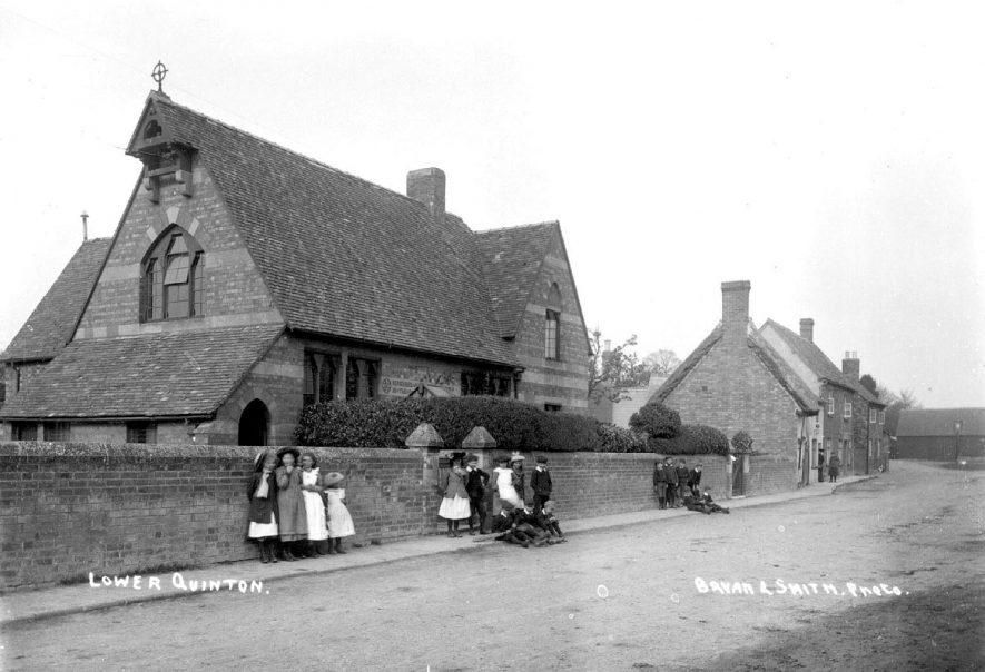 Group of children standing outside the school at Lower Quinton.  1900s |  IMAGE LOCATION: (Warwickshire County Record Office)