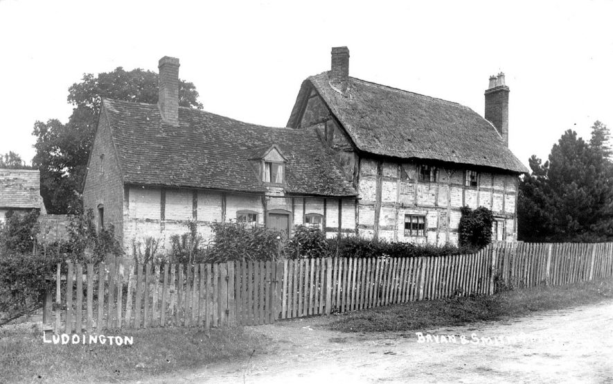 Timber framed, thatched cottages in Luddington.  1900s |  IMAGE LOCATION: (Warwickshire County Record Office)