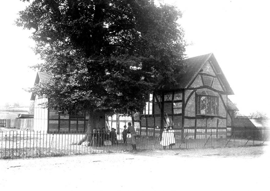 St Andrews school, Shottery  with a few pupils outside.  1900s |  IMAGE LOCATION: (Warwickshire County Record Office)