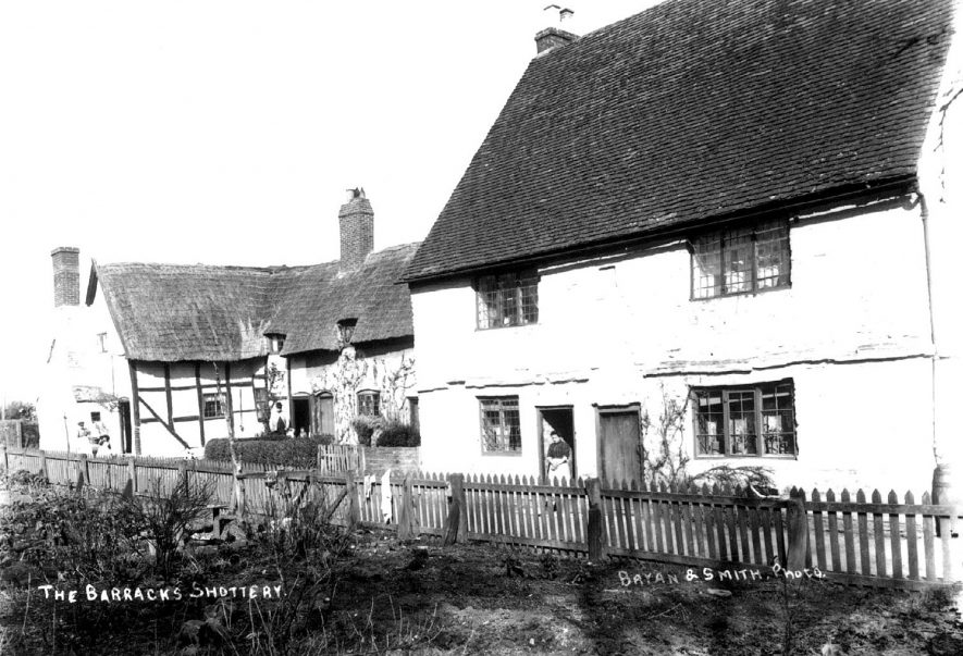 Cottages in Shottery known as the Barracks.  1900s |  IMAGE LOCATION: (Warwickshire County Record Office)