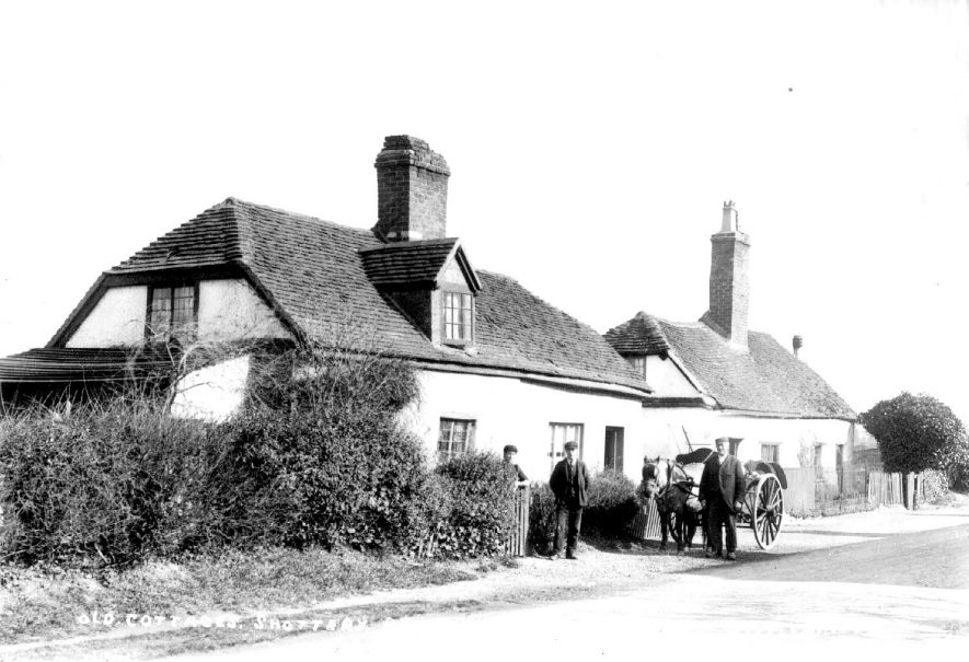 Old cottages with pony and trap and three men standing outside.  Stratford upon Avon.  1900s |  IMAGE LOCATION: (Warwickshire County Record Office)
