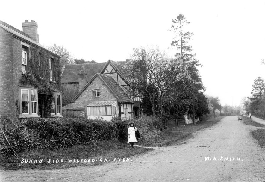 Child outside 'Sunny Side' cottage, Welford on Avon.  1900s |  IMAGE LOCATION: (Warwickshire County Record Office)