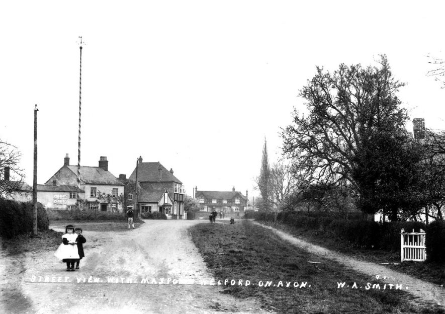 Street view with maypole in Welford on Avon.  1900s |  IMAGE LOCATION: (Warwickshire County Record Office)