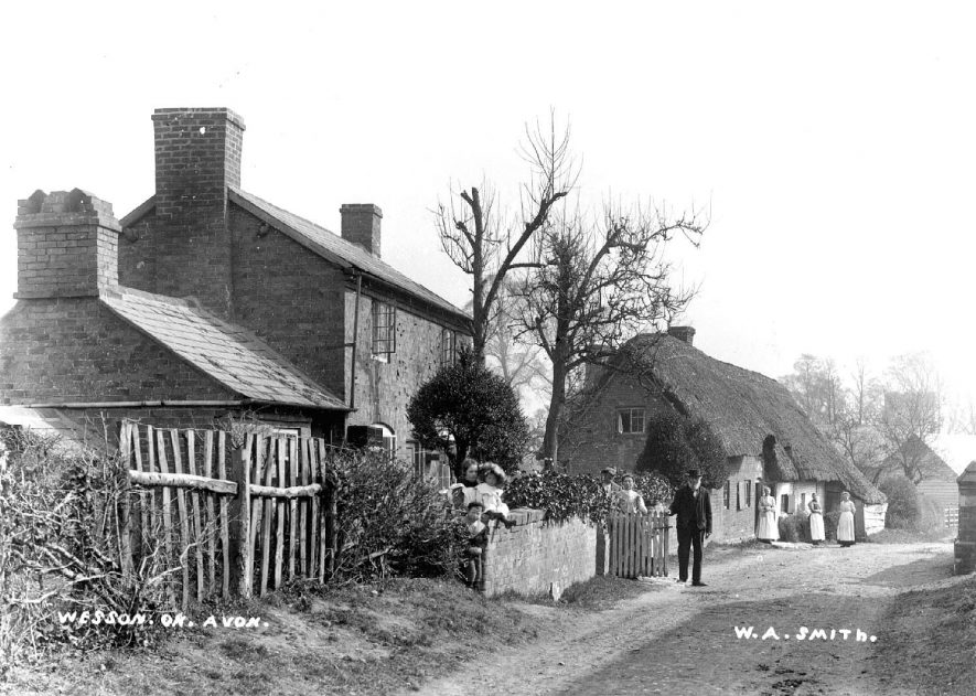 Cottages with people standing outside in Weston-on-Avon.  1900s |  IMAGE LOCATION: (Warwickshire County Record Office)