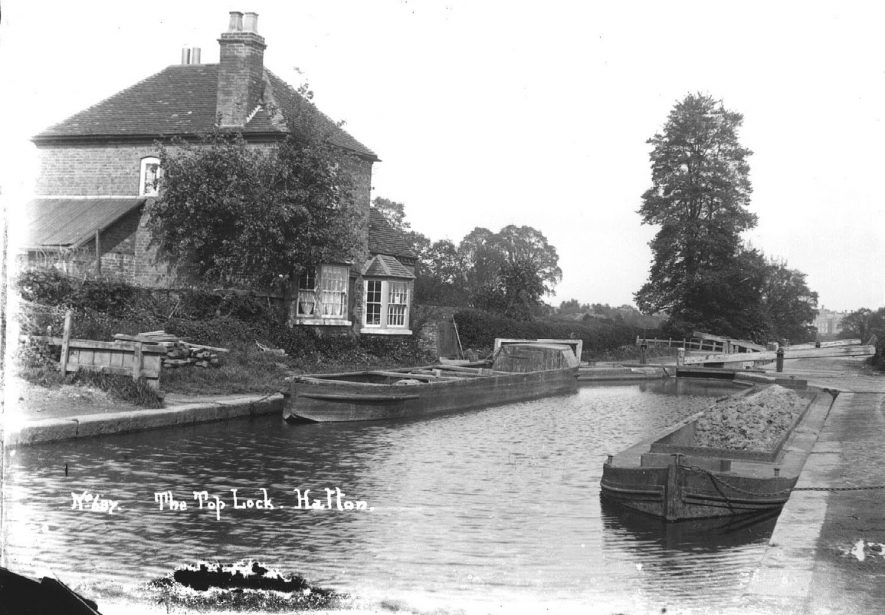 The Top Lock, Hatton. Canal, lock and two barges. Lock cottage.  1900s |  IMAGE LOCATION: (Warwickshire County Record Office)