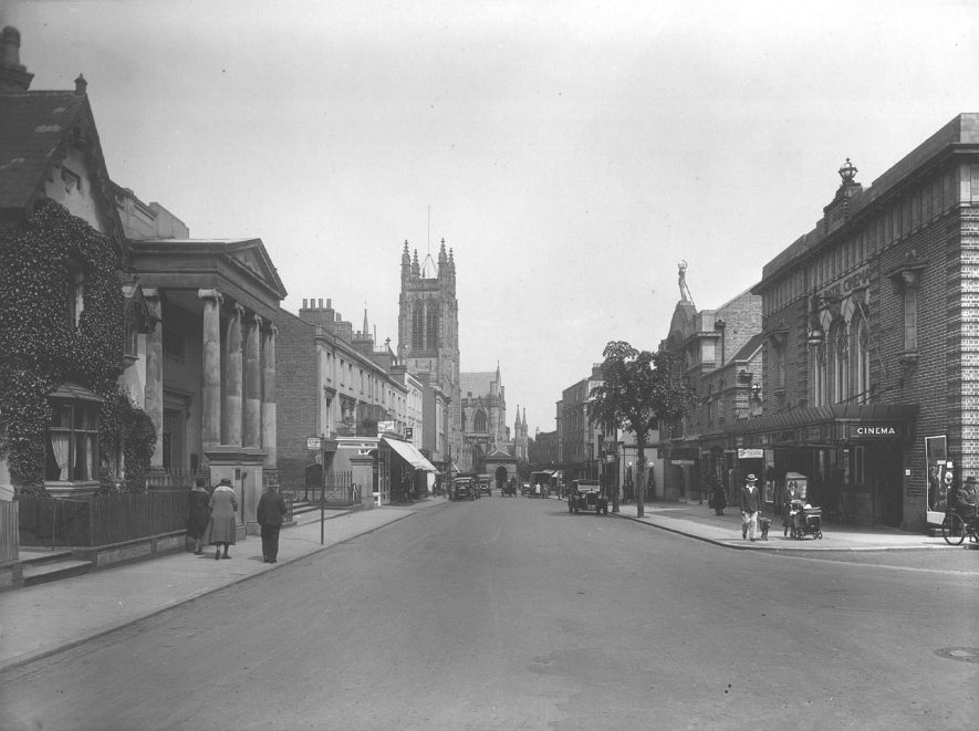 Spencer Street with view of church in the distance and people in the street, Leamington Spa.  1930 |  IMAGE LOCATION: (Warwickshire County Record Office)
