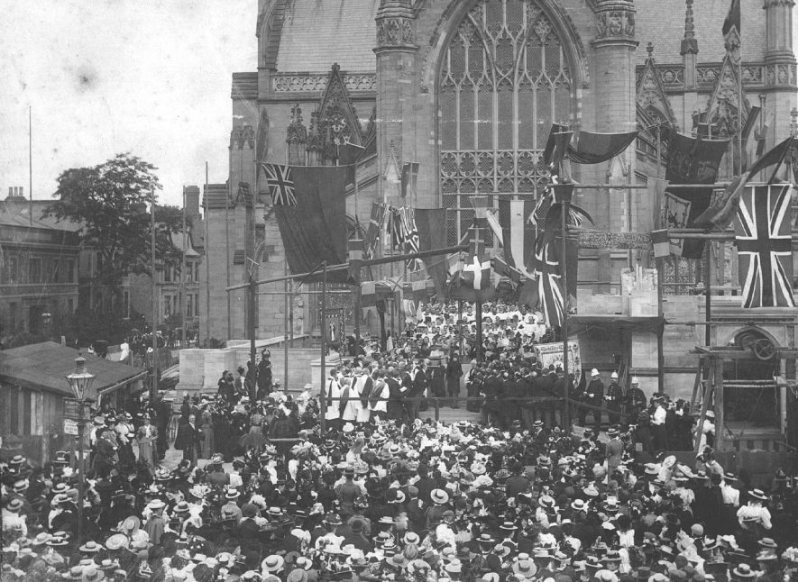 A celebration of some sort being carried out by clergy in front of All Saints Church before a large crowd, Leamington Spa.  1898 |  IMAGE LOCATION: (Warwickshire County Record Office)