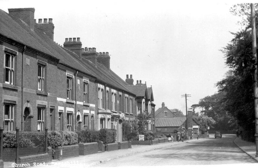 Church Road, Hartshill, showing terraced houses on the left.  1930s |  IMAGE LOCATION: (Warwickshire County Record Office)