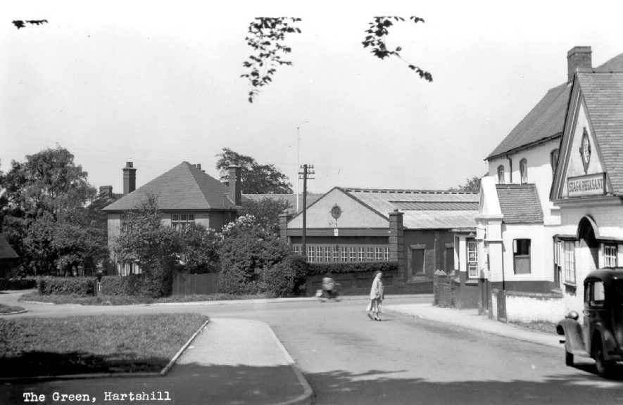 The Green, Hartshill, showing the Stag and Pheasant on the right hand side.  1930s    IMAGE LOCATION: (Warwickshire County Record Office)
