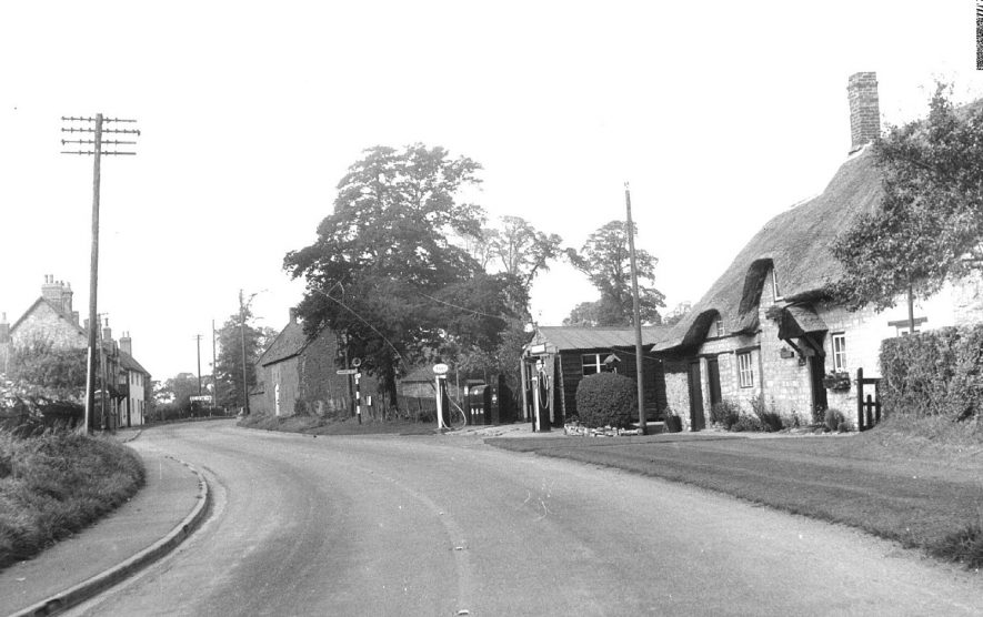Banbury Road, Ladbroke; with an Esso petrol station and thatched cottage.  1960 |  IMAGE LOCATION: (Warwickshire County Record Office)