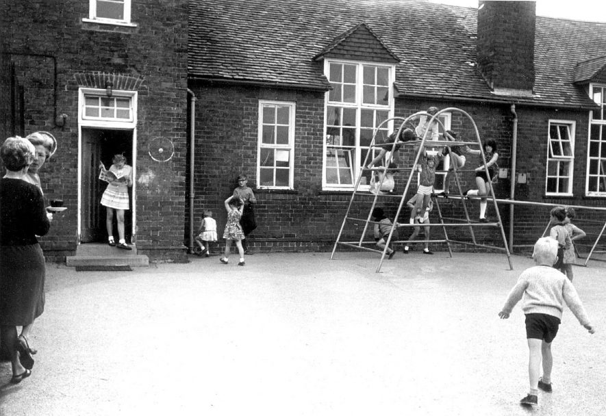 Maxstoke school playground with children playing.  1960s |  IMAGE LOCATION: (Warwickshire Museum Sites and Monuments Record)
