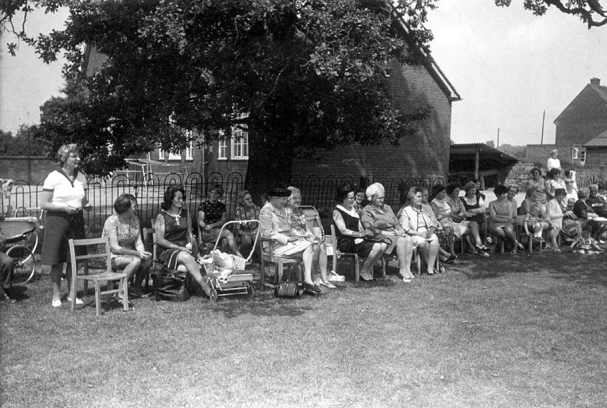 Spectators at Maxstoke school sports day. Photo by E.G. Miller, 99 Coventry Road, Coleshill.  1960s |  IMAGE LOCATION: (Warwickshire County Record Office)