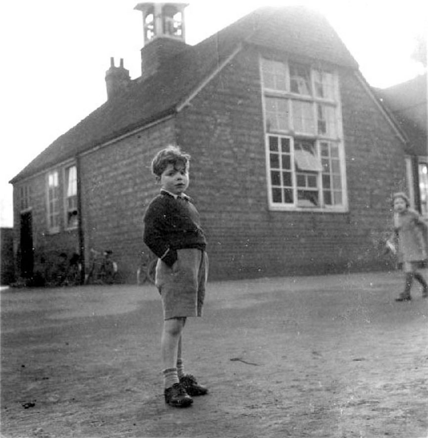 Chapel Street School with two children in the playground, Rugby.  1947 |  IMAGE LOCATION: (Warwickshire County Record Office)
