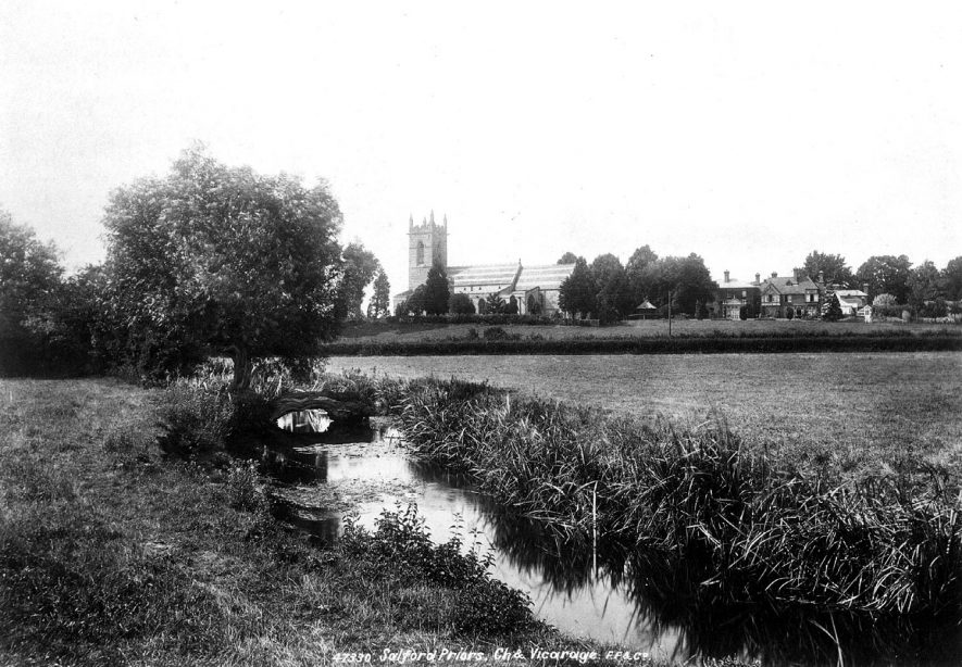 View of church & rectory across the meadows, Salford Priors.  1920s |  IMAGE LOCATION: (Warwickshire County Record Office)