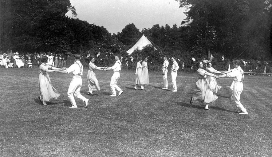 Folk dancing on a lawn with a tent and spectators in the background, Stratford upon Avon.  1930s |  IMAGE LOCATION: (Warwickshire County Record Office)