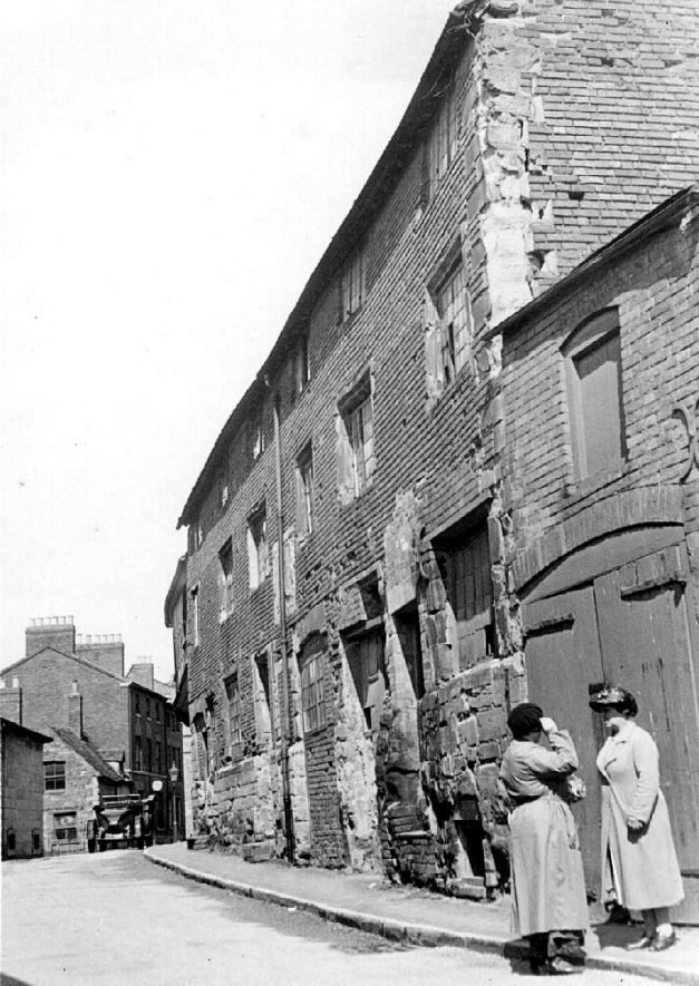 Barrack Street, showing old, terraced housing and two women, Warwick.  1930s |  IMAGE LOCATION: (Warwickshire County Record Office)