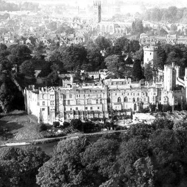 Warwick.  Aerial view of Castle and town