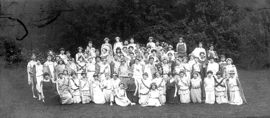 Group of performers in costume from production of