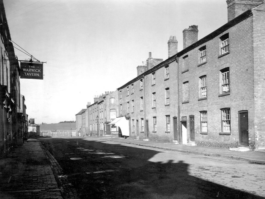 Crompton Street, Warwick, looking toward race course. Terraced housing, shop and  The Warwick Tavern public house.  1949 |  IMAGE LOCATION: (Warwickshire County Record Office)