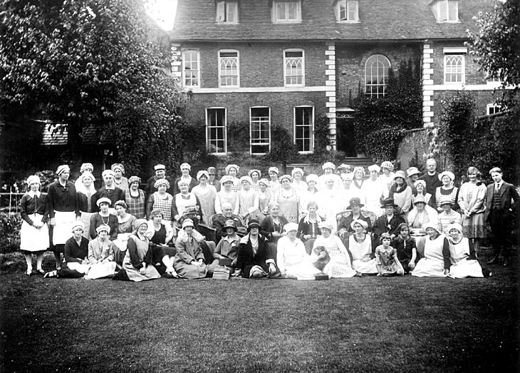 Large group of gentry and domestic servants in Lady llkeston's garden, Warwick.  1920 |  IMAGE LOCATION: (Warwickshire County Record Office) PEOPLE IN PHOTO: Ilkeston, Lady, Ilkeston as a surname