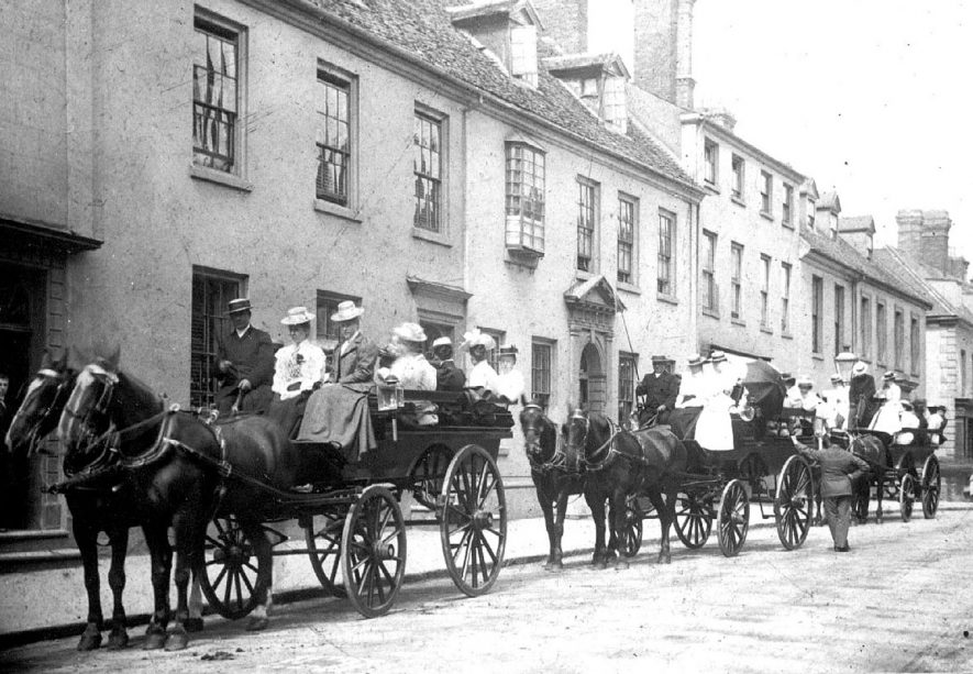Warwick High Street.  Start of a Y.W.C.A outing organised by Miss Bloore.  1900 |  IMAGE LOCATION: (Warwickshire County Record Office) PEOPLE IN PHOTO: Bloore, Gertrude Mary, Bloore as a surname