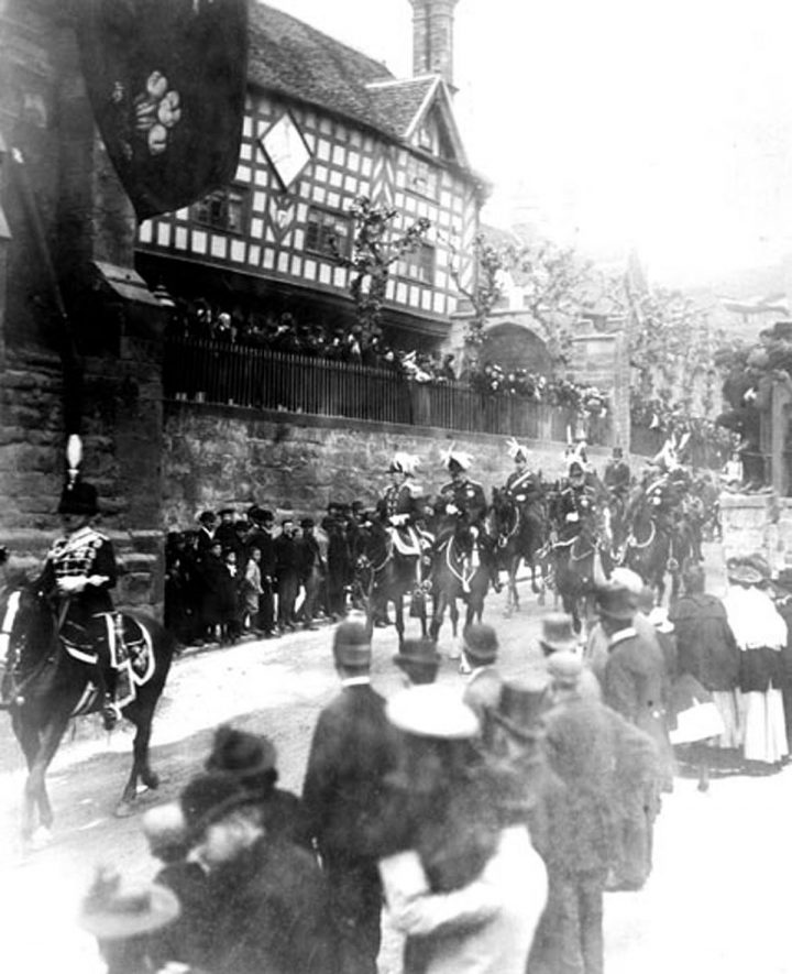 The Prince of Wales and other notables riding past the Leycester Hospital, Warwick.  1900 |  IMAGE LOCATION: (Warwickshire County Record Office)
