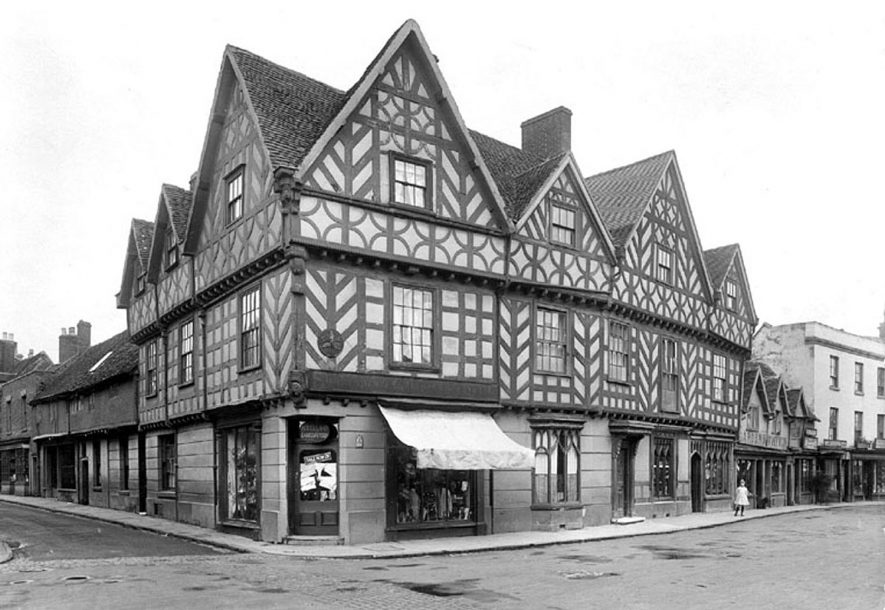 Half timbered buildings in the Cornmarket, Warwick.   1922 |  IMAGE LOCATION: (Warwickshire County Record Office)