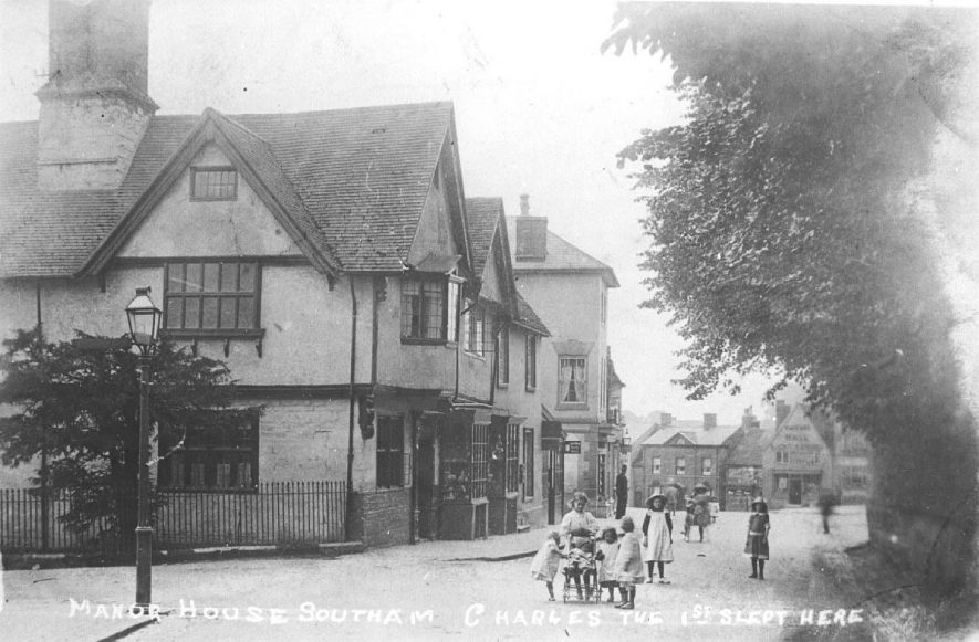 The Manor House, Southam showing children in the street, one of them in a push chair.  1920s