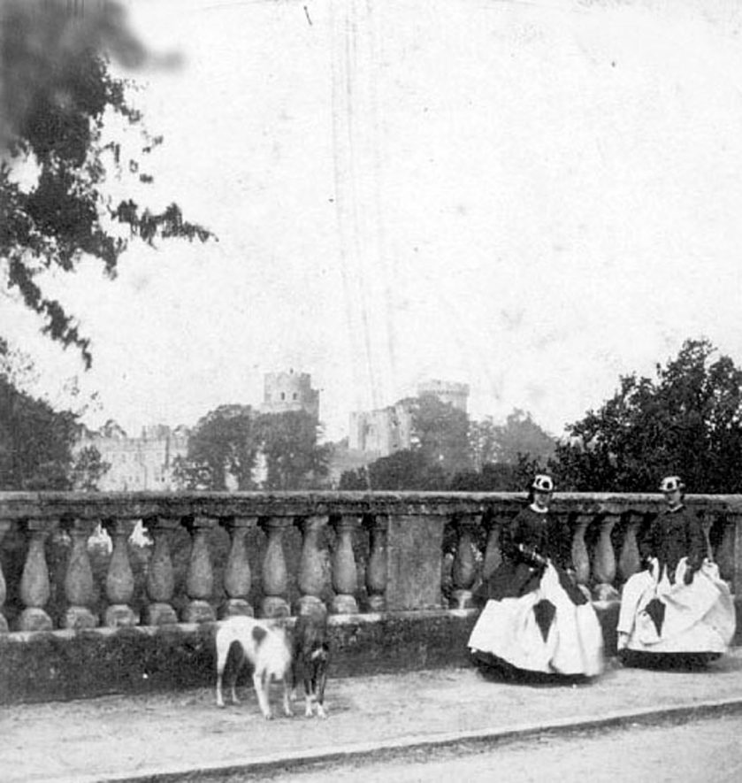 Warwick castle seen from the Banbury Road bridge. Two ladies & two dogs on bridge. 1850. |  IMAGE LOCATION: (Warwickshire County Record Office)