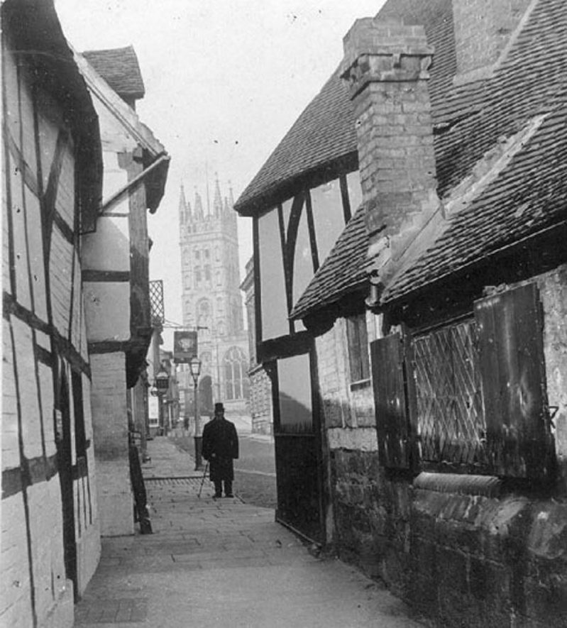 St Mary's Church from Oken's Passage, Warwick.  1870s  Half timbered buildings. |  IMAGE LOCATION: (Warwickshire County Record Office)