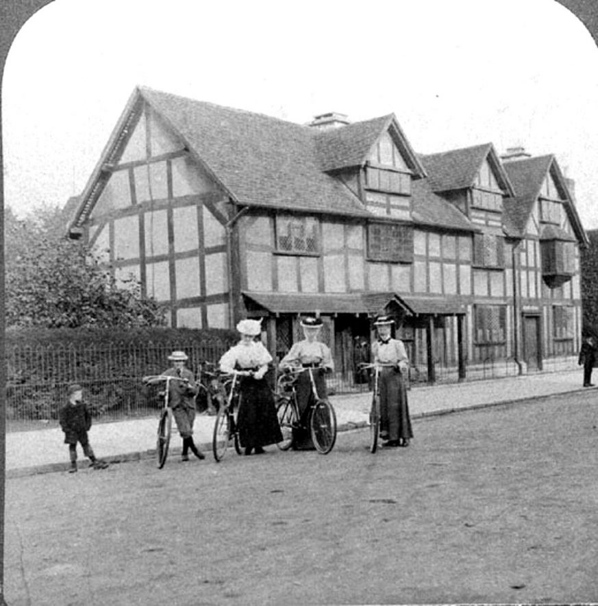 Shakespeare's Birthplace in Henley Street, Stratford upon Avon. Three ladies and one boy with bicycles. Another boy with them.  1900s    IMAGE LOCATION: (Warwickshire County Record Office)