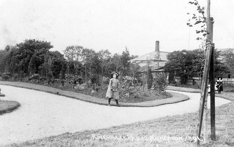Flower beds and glass house at Riversley Park, Nuneaton.  1900s |  IMAGE LOCATION: (Warwickshire County Record Office)