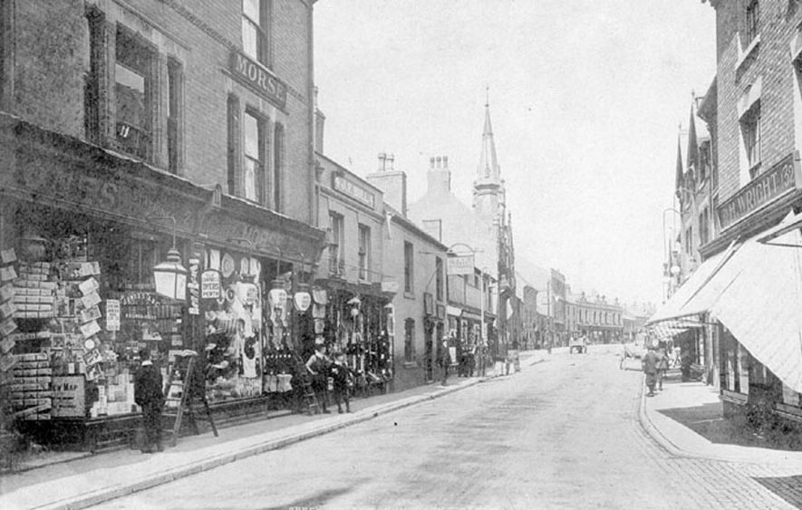 Abbey Street, Nuneaton showing shops on either side.  1900s |  IMAGE LOCATION: (Warwickshire County Record Office)