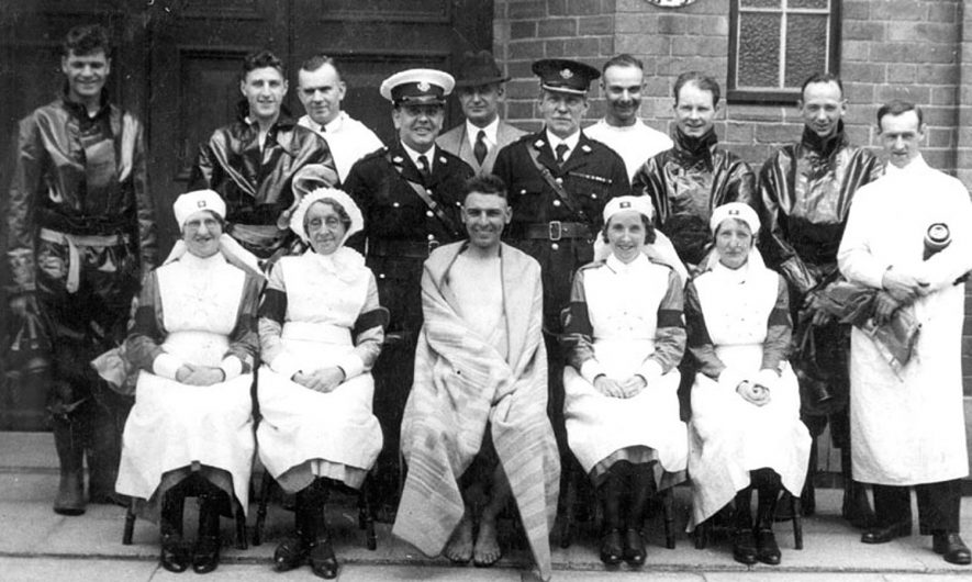 Group of nurses,? divers and other health personnel in Nuneaton.  1930s |  IMAGE LOCATION: (Warwickshire County Record Office)