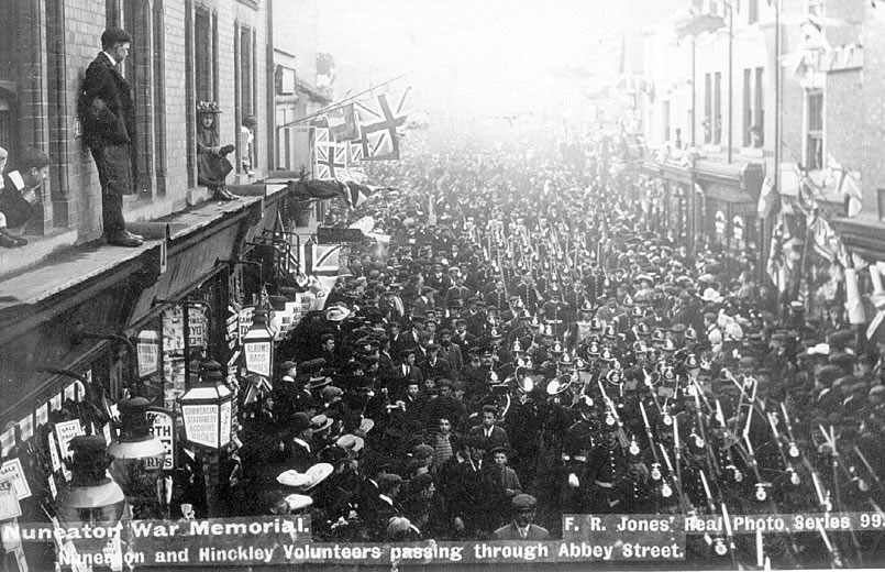 Large parade of the Nuneaton and Hinkley Volunteers passing through Abbey Street, Nuneaton.  1900s |  IMAGE LOCATION: (Warwickshire County Record Office)