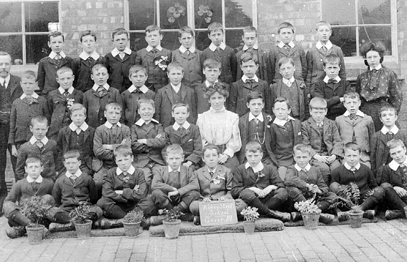Group photograph of class of boys at Abbey Street School, Nuneaton. One male, one female teacher.  1900s |  IMAGE LOCATION: (Warwickshire County Record Office)