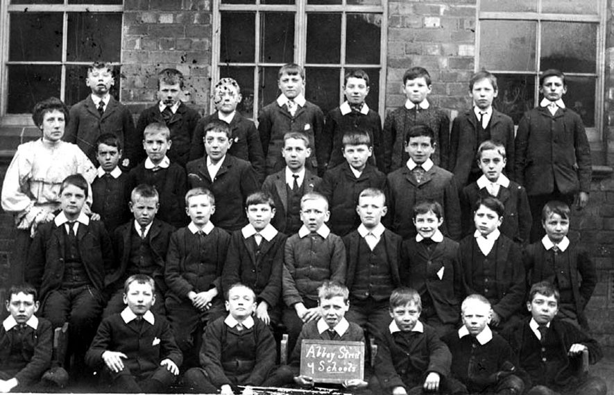 Group photograph of class of boys at Abbey Street School, Nuneaton. One female teacher.  1900s |  IMAGE LOCATION: (Warwickshire County Record Office)