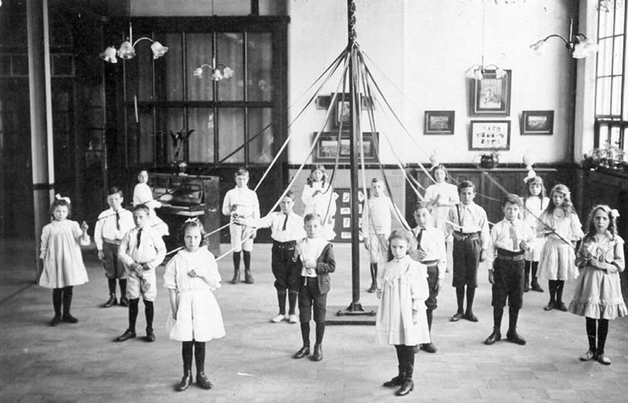 Pupils at Abbey Street School, Nuneaton, posing with maypole in school hall.  1900s |  IMAGE LOCATION: (Warwickshire County Record Office)
