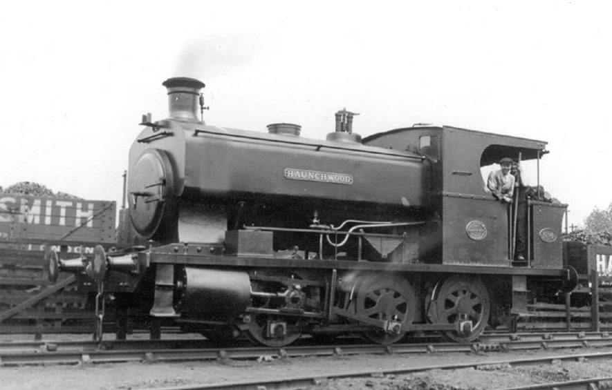 Steam engine attached to coal trucks. Name