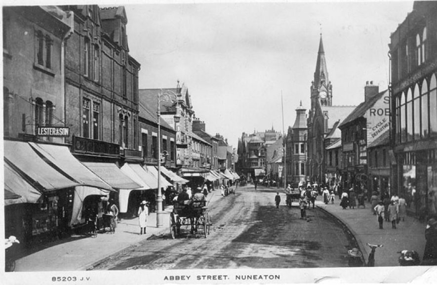Abbey Street, Nuneaton, showing shops, pedestrians and horse-drawn vehicles.  1920s |  IMAGE LOCATION: (Warwickshire County Record Office)