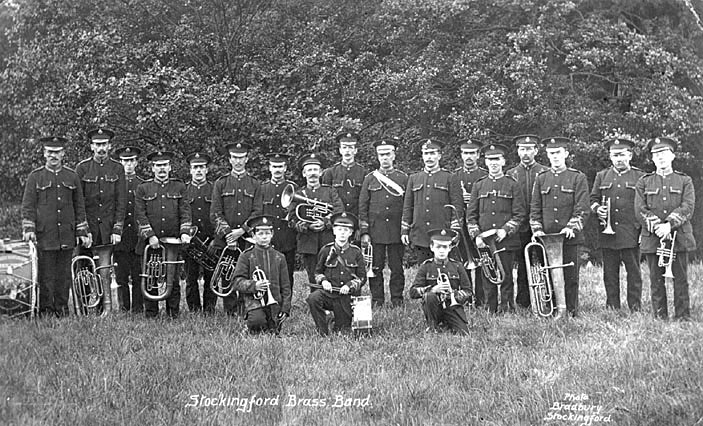 Nuneaton. Stockingford Brass Band group photograph, showing instruments and uniformed men.  1910s |  IMAGE LOCATION: (Warwickshire County Record Office)