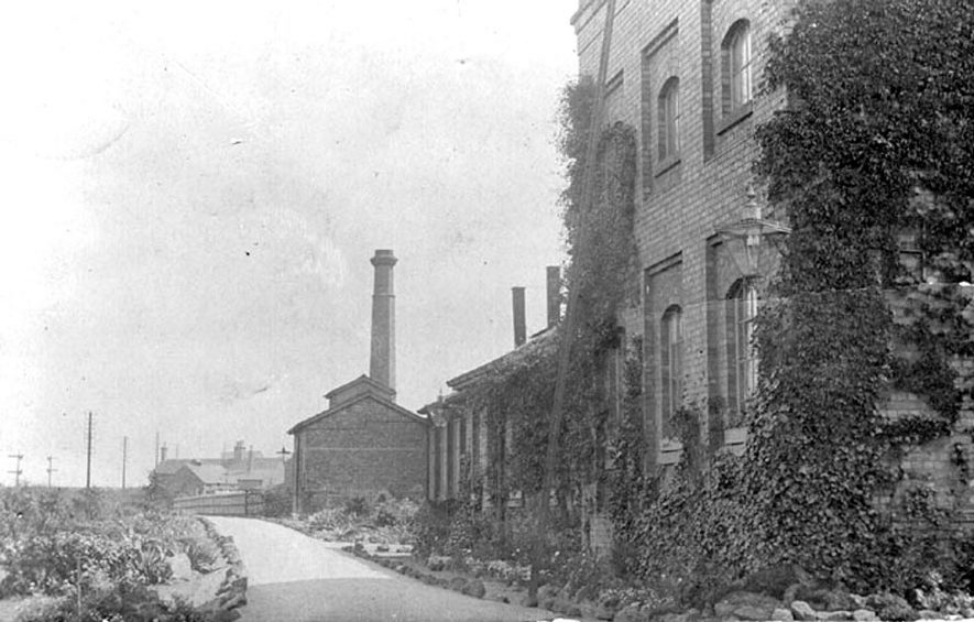 Factory buildings, possibly a wool mill, close to the railway line in Nuneaton.  1900s |  IMAGE LOCATION: (Warwickshire County Record Office)