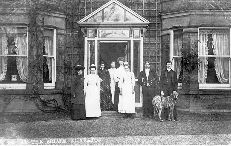 Group of domestic staff at the entrance to The Briars, home of Bertram Hardy. Nuneaton.  1900s |  IMAGE LOCATION: (Warwickshire County Record Office)