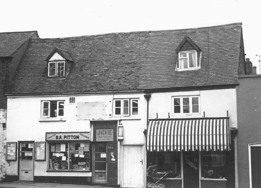 4 & 5, High Street, Southam; showing S A Pittom, stationers and printers and Jackie, hairdressers.  c. 1973 |  IMAGE LOCATION: (Warwickshire County Record Office)