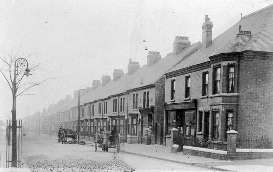 Row of terraced houses and W.H. Spencer's grocery shop, Arbury Road, Nuneaton.  1900s |  IMAGE LOCATION: (Warwickshire County Record Office)